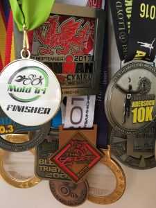selection of finisher medals from 2017 triathlon season